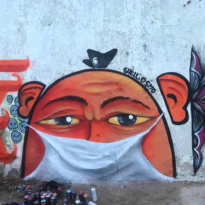 Grafite de Shell Osmo com pessoa de máscara